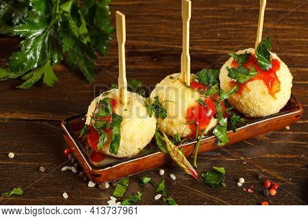 Traditional Italian Appetizer, Rice Balls With Cheese. Arancini On A Rectangular Plate, Close-up.