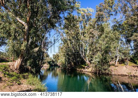 The Jordan River is the most famous river in the world. Israel. In Christianity, Jordan is the place of the baptism of Christ. The fine warm winter sunny day