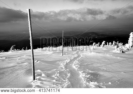Snow-covered Tourist Trail In The Giant Mountains In Poland, Monochrome