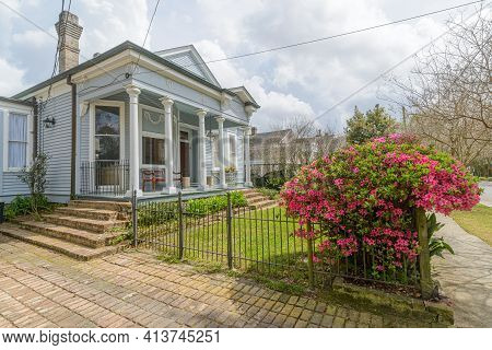 New Orleans, La - March 15: Historic Victorian House From The 1890s With Blooming Azalea Bushes On M