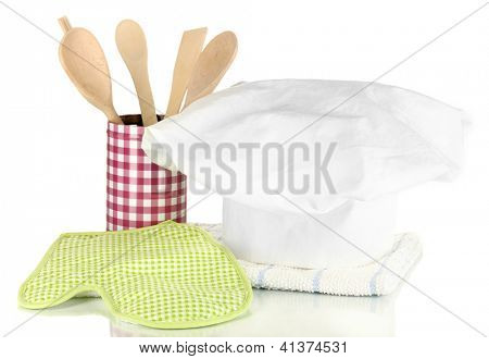 Chef's hat with kitchen towels, potholders and kitchenware isolated on white