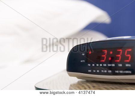 Empty Bedroom With Focus On Alarm Clock