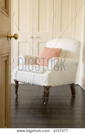 Empty Chair Shot Through Doorway