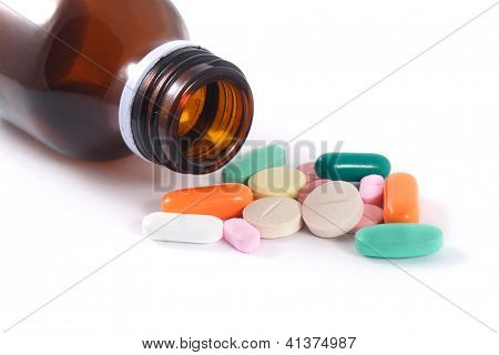 Various pills and bottle