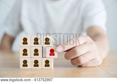 Human Resource Management And Recruitment Business Concept. Hand Holding Wooden Cube Block With Huma