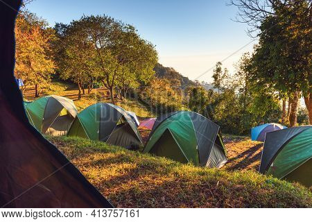 Campground Adventure With Camping Tent Of Tourist Backpack, Resting Campfire Picnic At The Highland