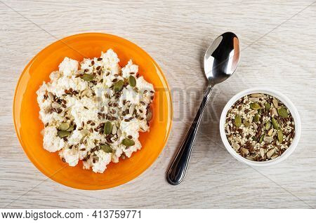 Orange Glass Bowl With Cottage Cheese And Mix Of Different Seeds, Teaspoon, White Bowl With Pumpkin