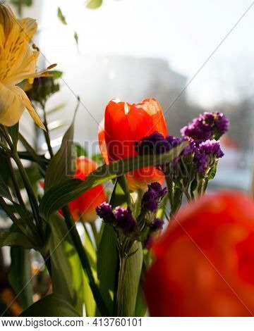Bouquet Of Flowers Indoors On A Sunny Day. Lily, Tulips, Lilac Wildflowers. Vertical Photo
