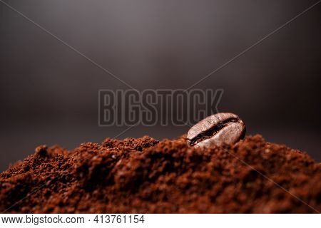 Closeup Of Coffee Beans At The Mixed Heap Of Roasted Coffee With Copy Space For Text. Concept Of Cof
