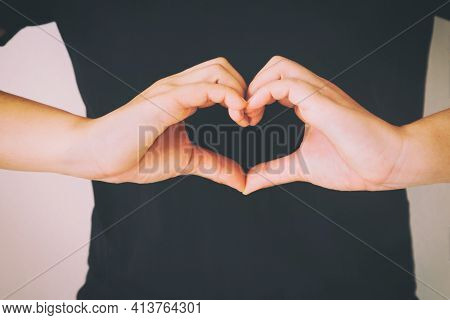 Woman Wear Black Shirt And Gesture Hands For Heart Shape. Concept For Love, Help, Kindness, Donate,