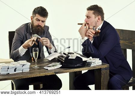 Company In Illegal Business. Men Sitting At Table With Piles Of Money. Illegal Business Concept. Bus