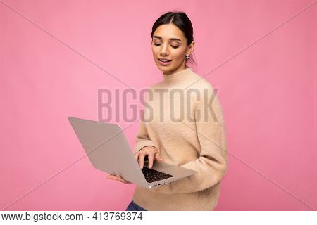 Close-up Portrait Of Beautiful Young Brunette Woman Wearing Beige Sweater Holding Netbook Computer T