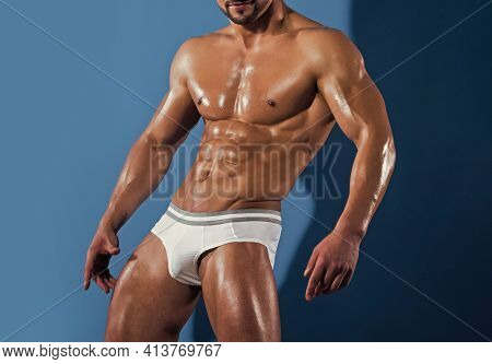 Man With Muscular Body And Bare Chest On Blue Background. Sexy Muscled Male Model Strong Nude Body.