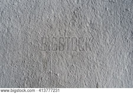 Gray Rough Background Wall Painted. Gray Texture Of Rough Painted Surface