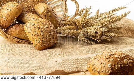 Baguette Bread. Rye Bakery With Crusty Loaves And Crumbs. Fresh Loaf Of Rustic Traditional Bread Wit