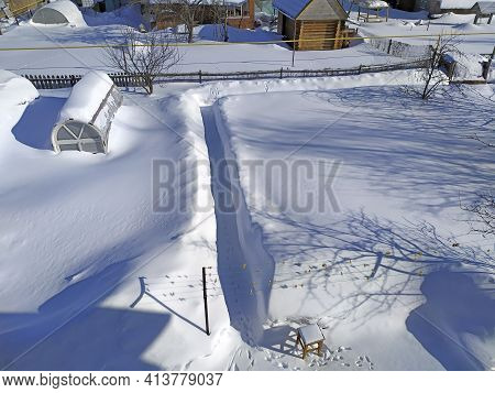 Huge Drifts Of Snow At Their Summer Cottage. The Greenhouses Are Completely Covered In Snow. Snow Co