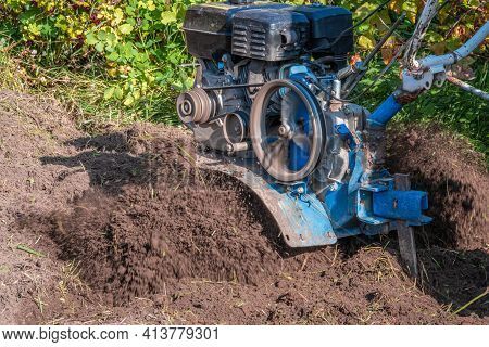 Agricultural Machinery: Motorized Hand Plow.
