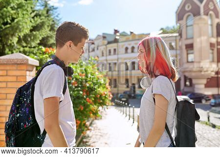 Couple Of Teenage Students 16, 17 Years Old Talking On City Street