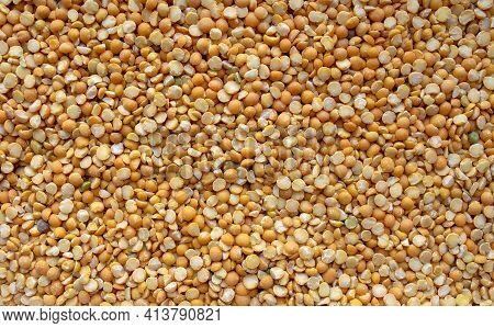Dry Split Yellow Peas Background. Yellow Dried Peas Background. Top View. Food Background. Peas Grai