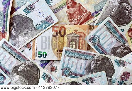 Euro Banknote On The Top Of Egypt National Currency Backdrop. Money Banknotes. Egyptian Pound Bankno