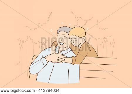 Happy Childhood And Parenting Concept. Smiling Senior Man Sitting On Bench And Feeling Hugs Of His G