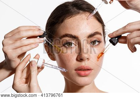 Beauty Face Of Woman With Freckles, Natural Clean And Fresh Glowing Skin, Apply Anti-aging Collagen