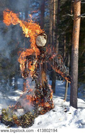 Burning Scarecrow On Festival Maslenitsa. Slavic National Spring Pagan Festival - Maslenitsa. Burnin