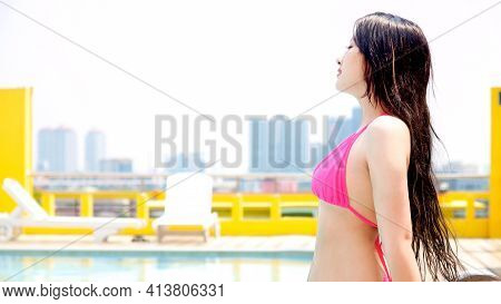 Healthy Athletic Woman Go Swimming With Bikini To Be Fresh In Swimming Pool. Asian Swimmer Woman Aft