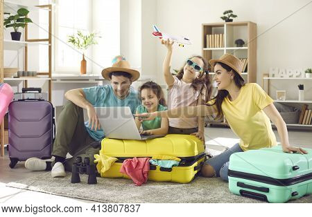 Happy Family And Kids With Travel Suitcase Buying Ticket Booking Hotel Online