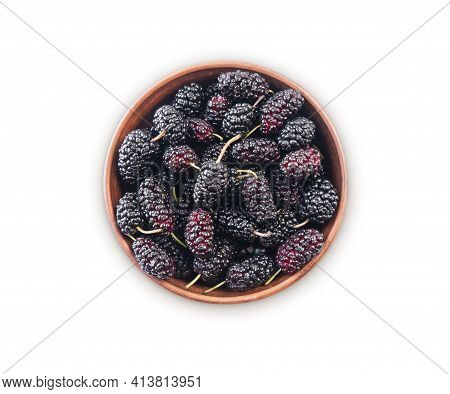 Blueberries In Bowl Isolated On White Background. Black Mulberry On White Background. Ripe And Tasty