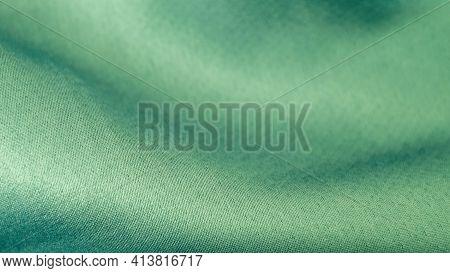 Beautiful Wavy Silk Fabric In Aqua Color. Smooth Elegant Luxury Cloth Fabric Texture. Abstract Green