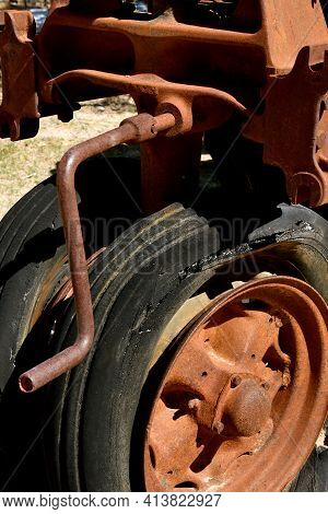 An Old Rusty Crank  For Starting A Tractor Is Left In The Engine Block