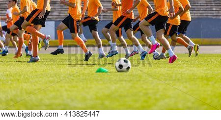 Football Club Training Session. Soccer Players On Daily Practice Unit. Athletes Running On Soccer Gr