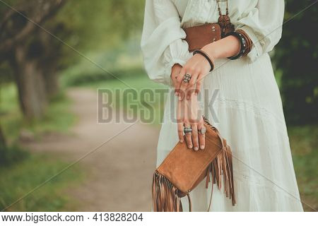Fashionable Female Accessories On Woman Outdoor. Jewelry Rings, Wooden Bracelet, Suede Womens Handba
