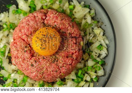 Beef Steak Tartare With Raw Egg Yolk And Onion With Chive, Appetizer