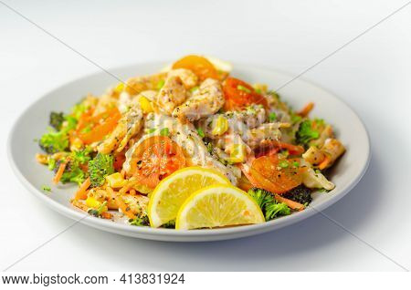 Piri Piri Style Chicken On A Bed Of Wholewheat Pasta And Vegetables, With A Cool Sour Cream And Chiv