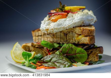 Egg In A Cloud On Grilled Sandwiches With Cumberland Sausage, Tomato And Mayonnaise, All Served With