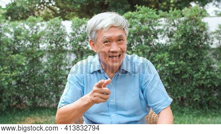 Asian Senior Man Video Call At Home. Asian Senior Older Chinese Male Using Mobile Phone Video Call T