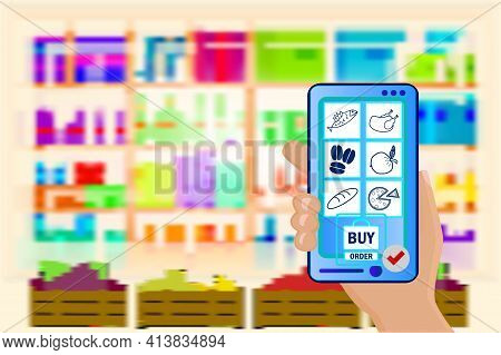 Hand Holds A Mobile Phone With A Grocery Order On Supermarket Blurry Shelves Background. Supermarket
