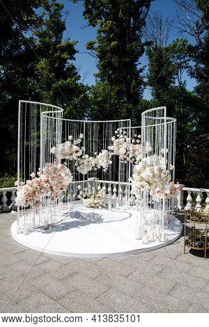 Wedding Arch For Wedding Of Newlyweds. Wedding Celebration Outdoors In The Park. Wedding Ceremony De