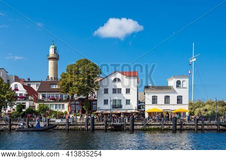 Lighthouse On The Baltic Sea Coast In Warnemuende, Germany.