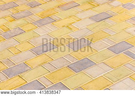 Colored Light Paving Tile Floor Texture Urban Background.