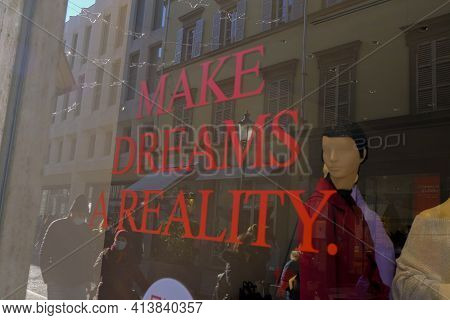 December 2020 Milan, Italy: Store Window's Display With Mannequins And Red Text Make Dreams A Realit