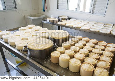 São Roque De Minas - Mg, Brazil - December 12, 2020: Process Of Salting The Cheese With Coarse Salt