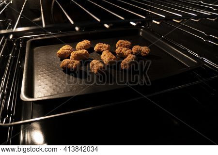 Frozen Scampi Being Baked In An Oven