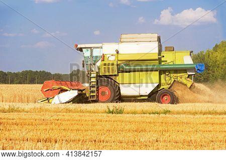 Harvester Machine To Harvest Wheat Field Working. Combine Harvester Agriculture Machine Harvesting G
