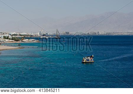 Two Pleasure Boats Sail In The Red Sea During The Day Near The Coast Of Eilat In Israel The Coast Of