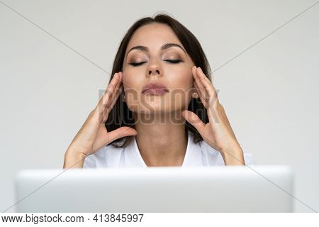 Woman Feeling Headache, Weakness, Massaging Temples, Tired, Exhausted From Work On Laptop At Home Of