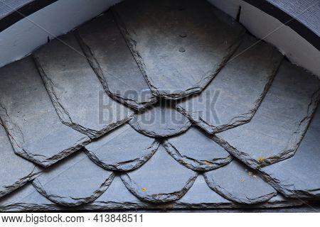 The Dark Slate On A Roof Gable
