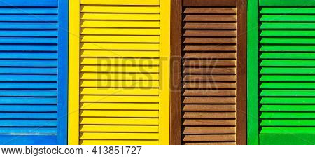 Part Of Modern Interior With Colorful Patterned Texture Of Wooden Shutters, Casements Or Blinds Back